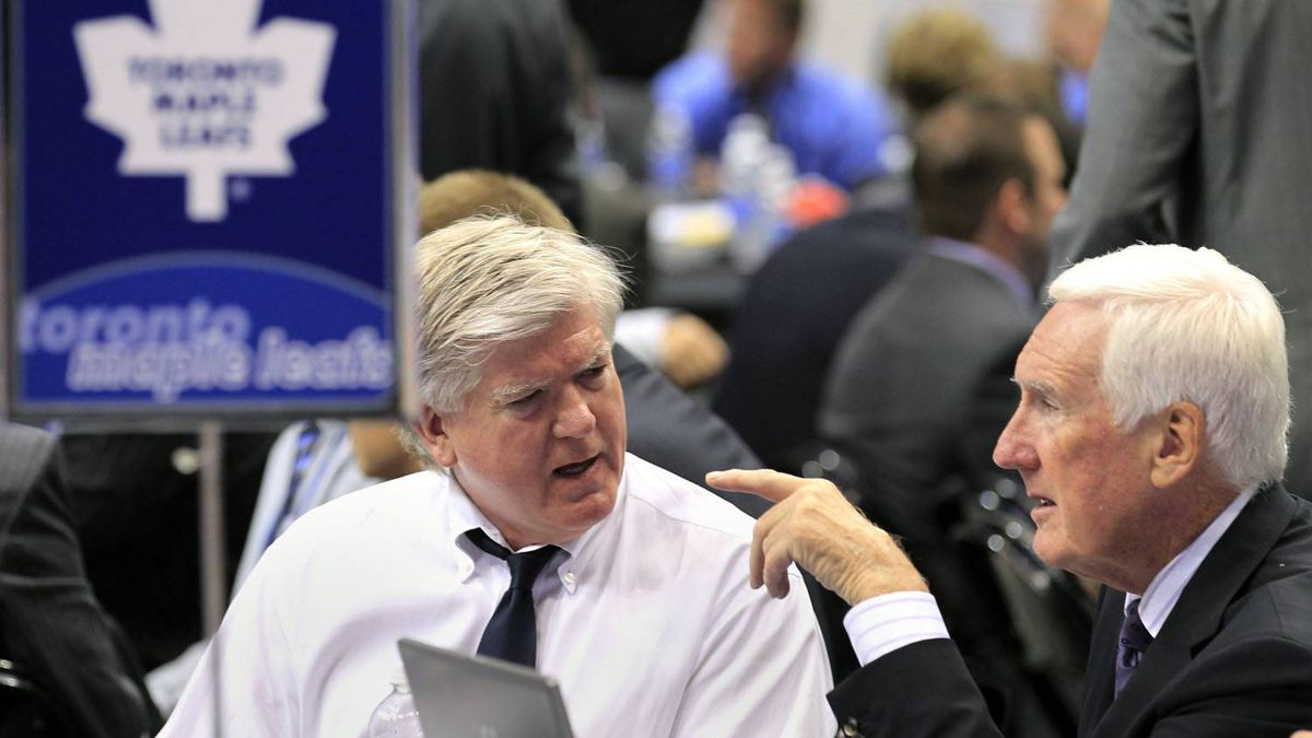 Toronto Maple Leaf's General Manager Brian Burke (L) and team advisor Cliff Fletcher chat before the first round of the 2010 NHL hockey entry draft in Los Angeles, California June 25, 2010. REUTERS/Mike Blake