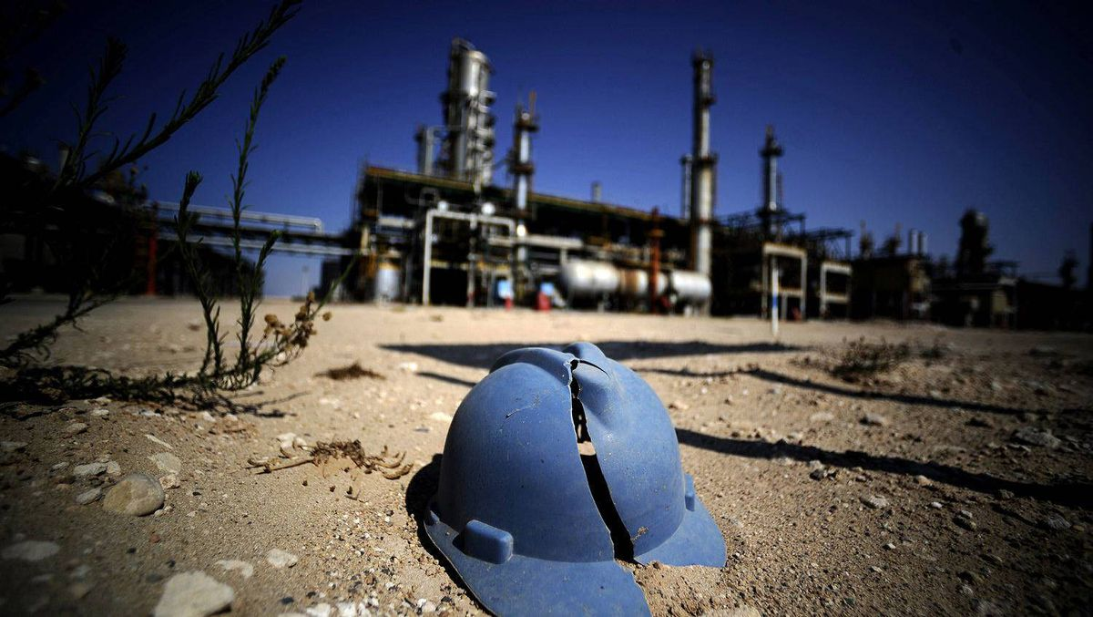 A worker's helmet lies on the ground at the Zawiya oil refinery Aug. 19, 2011.