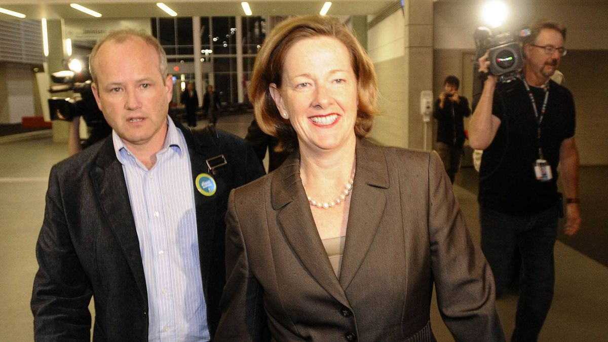 Before her win, Alberta Progressive Conservative party leadership candidate Alison Redford (C) enters the convention center before the results of the leadership race in Edmonton Oct. 1, 2011.