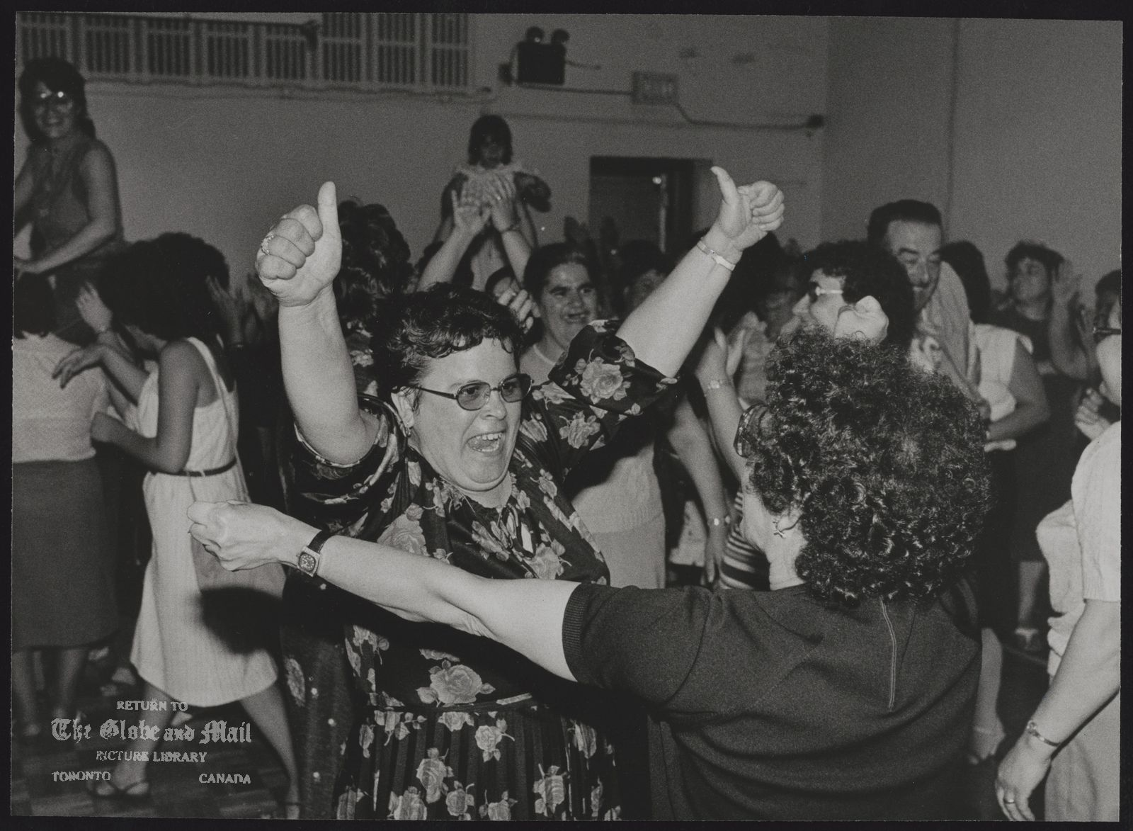 FOOD AND SERVICE WORKERS OF CANADA Cleaning lady Mara Haruda (middle) exults in victory after her union ratified agreement ending the six-week strike at First Canadian Place.