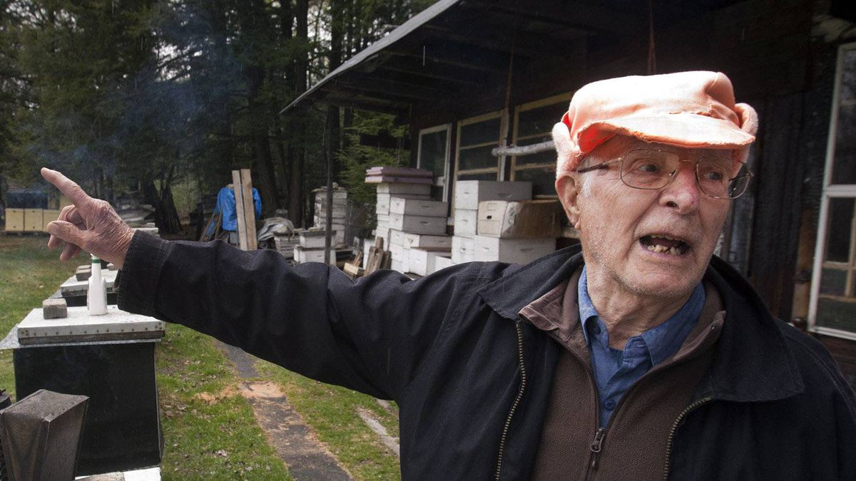 Vladimir Katriuk points at his honeybee farm in Ormstown, Que., Wednesday, April 25, 2012.