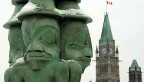 The Three Watchmen, by Haida artist James Hart, keep vigil over the Parliament Buildings in Ottawa.