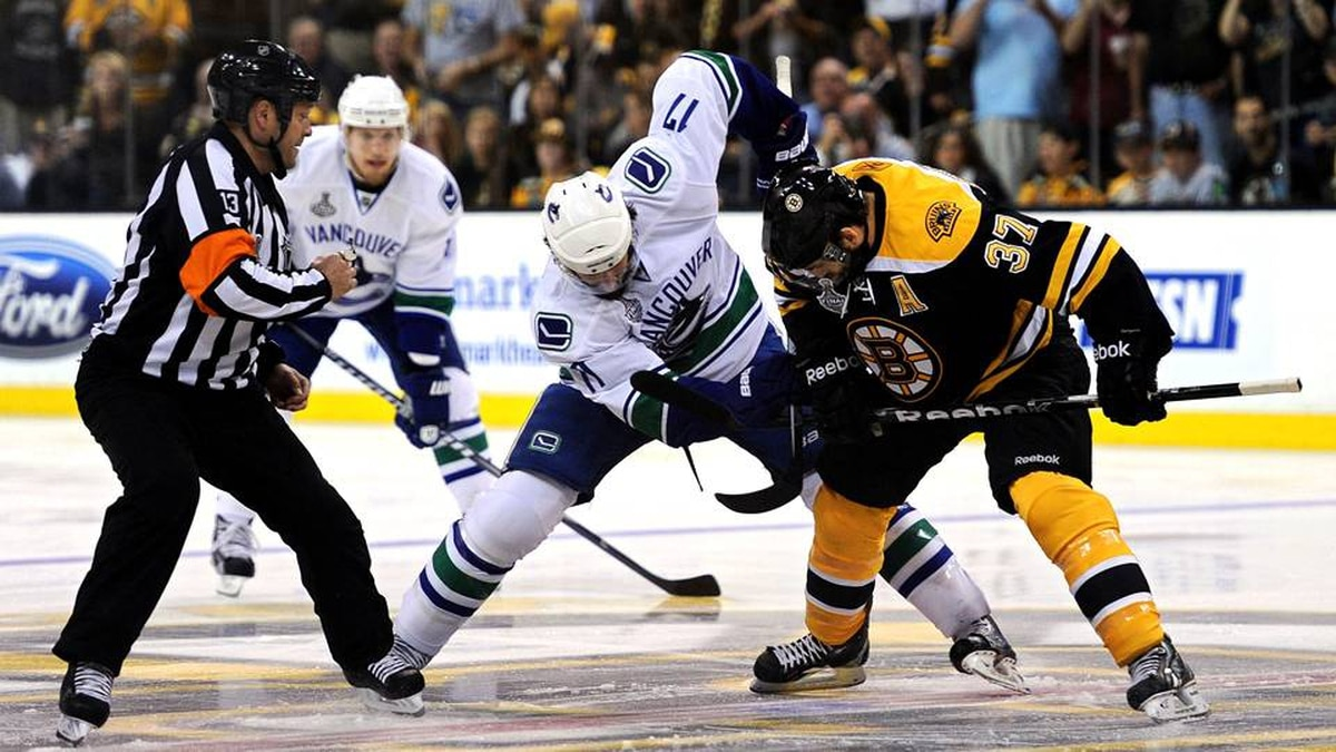 Patrice Bergeron of the Boston Bruins faces off against Ryan Kesler of the Vancouver Canucks to start Game 6.