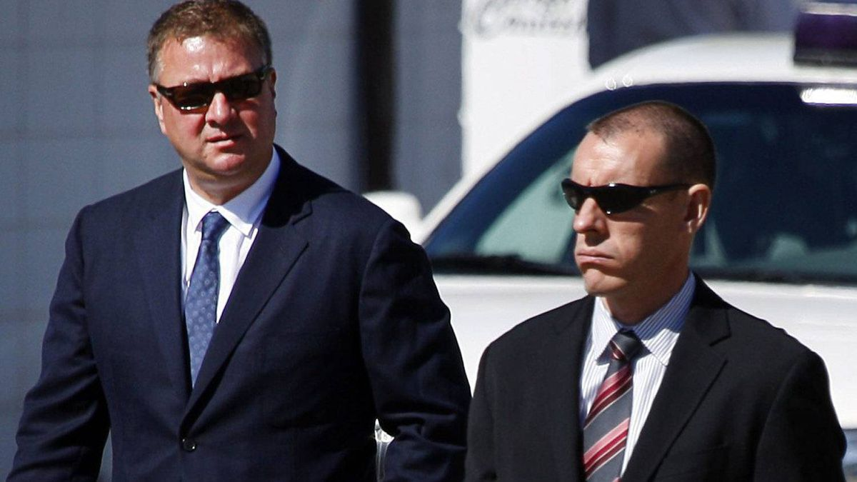 Vancouver Canucks general manager Mike Gillis, left, attends the funeral service for former teammate Rick Rypien, 27, in Blairmore, Alta., Saturday, Aug. 20, 2011. Rypien was found dead in his off-season Coleman, Alta., home on Aug. 15. He had just signed with the Winnipeg Jets last month after six seasons with the Vancouver Canucks. THE CANADIAN PRESS/Jeff McIntosh
