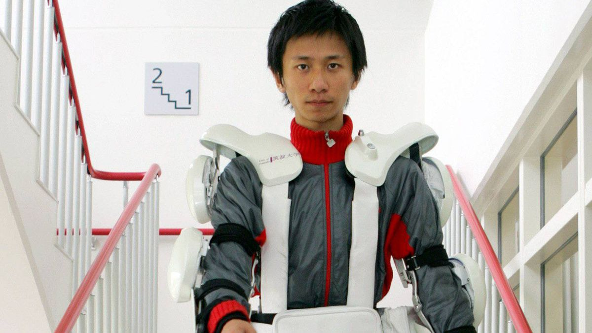 A graduate school student wearing the robot suit Hybrid Assistive Limb (HAL) 5, developed by professor Yoshiyuki Sankai, walks down on steps during a test at the University of Tsukuba, northeast of Tokyo, on June 24, 2005.