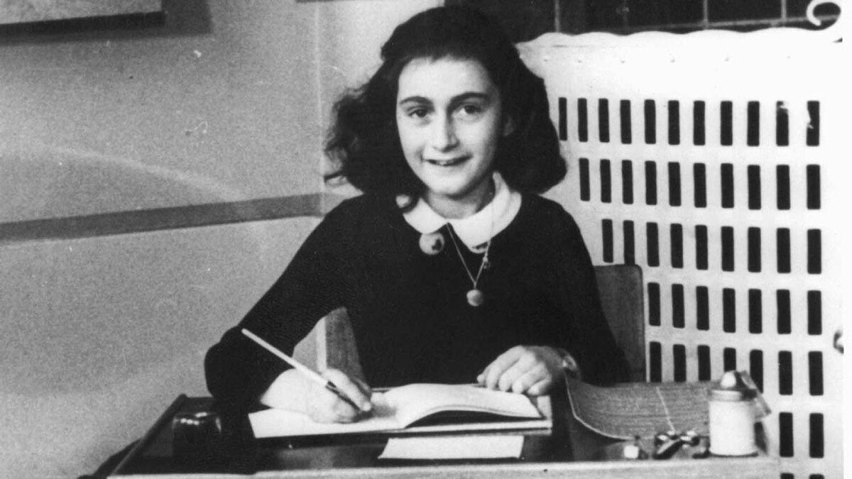 Anne Frank at a desk