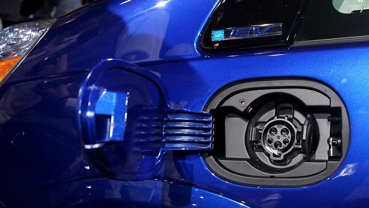 The charging port on the new all-electric Honda Fit EV is seen during its debut at the Los Angeles Auto Show Wednesday, Nov. 16, 2011.
