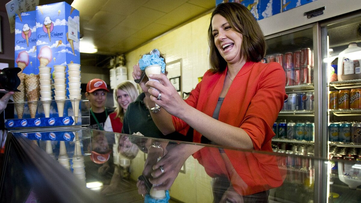 Wildrose Leader Danielle Smith serves ice cream at a campaign stop in Strathmore, Alta., on Saturday.