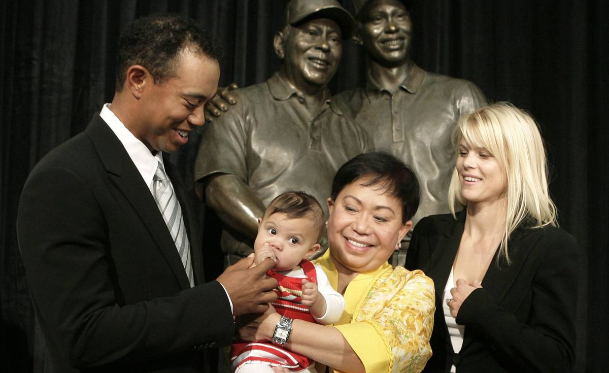 Golfer Tiger Woods, his daughter Sam, his mother Kultida and his wife Elin Nordegren pose together in front of a bronze statue bearing the likeness of Tiger with his late father Earl during its unveiling inside the Tiger Woods Learning Center in Anaheim, California on January 21, 2008.