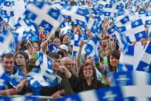 A crowd waves Quebec flags during the St. Jean Baptiste celebrations on the Plains of Abraham on June 23, 2009.