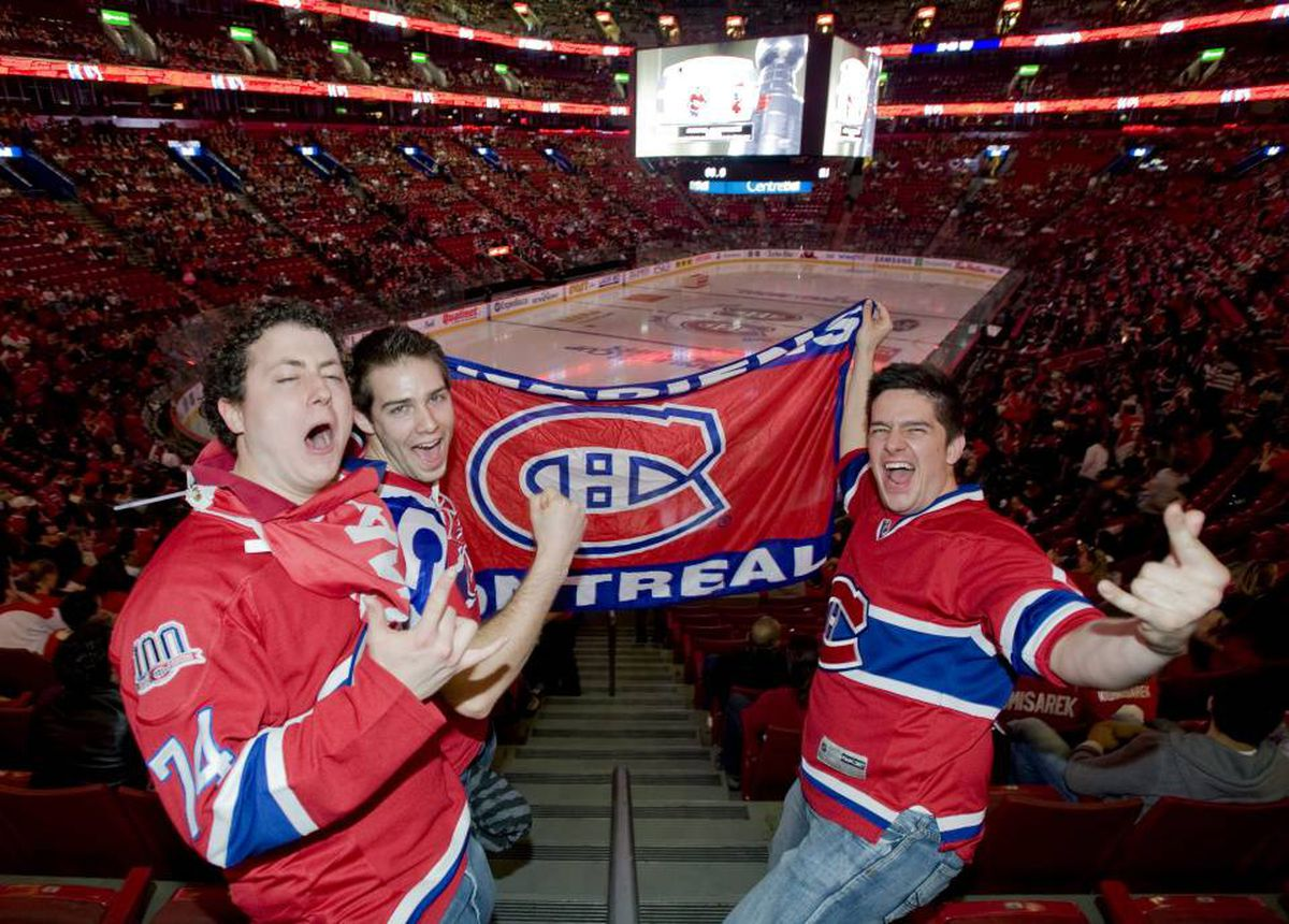 Montreal Canadiens' fans, from left, Bruno Paradise, Felix Pilote and Pierre-Luc Lachapelle cheer for their team at the Bell Centre in Montreal, Wednesday, May 12, 2010 prior to game 7 of an NHL hockey Eastern Conference semifinal series between the Canadiens and the Pittsburg Penguins.