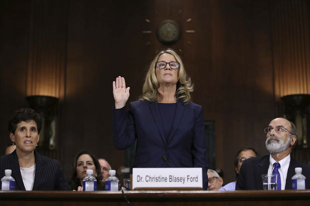 Christine Blasey Ford is sworn in before the Senate Judiciary Committee, Thursday, Sept. 27, 2018 in Washington. Her attorney's Debra Katz and Michael Bromwich watch. WIN MCNAMEE/THE ASSOCIATED PRESS