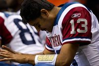 Montreal Alouettes' quarterback Anthony Calvillo sits on the bench while playing the B.C. Lions during the second half of a CFL football game in Vancouver on Saturday.
