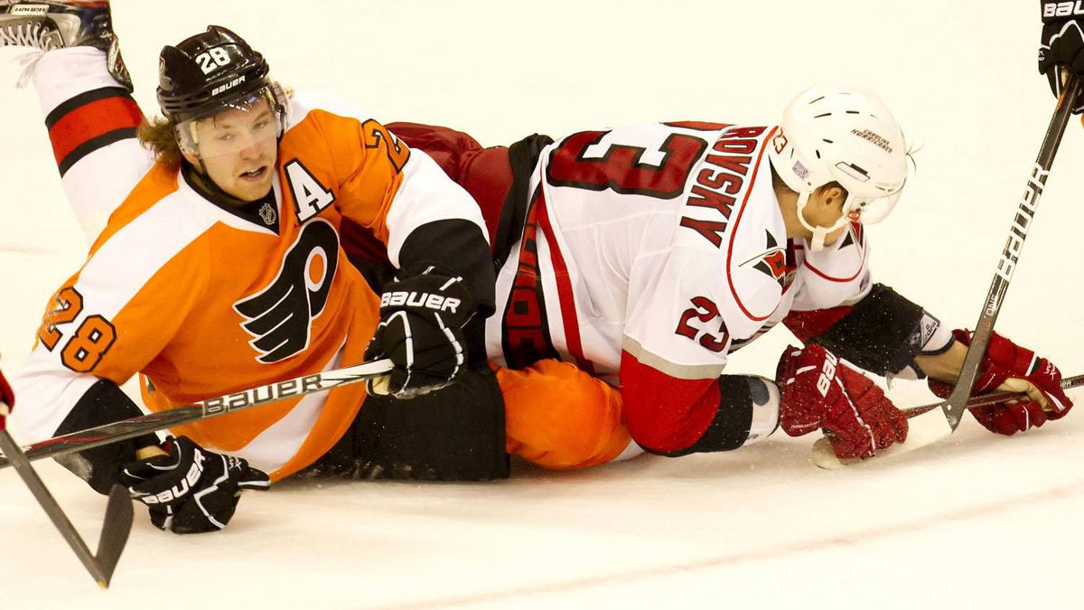 hiladelphia Flyers center Claude Giroux (28) looks up as he is tangled with Carolina Hurricanes left wing Alexei Ponikarovsky (23) during the 3rd period at the Wells Fargo Center. The Flyers beat the Hurricanes, 5-1. Mandatory Credit: Christopher Szagola-US PRESSWIRE