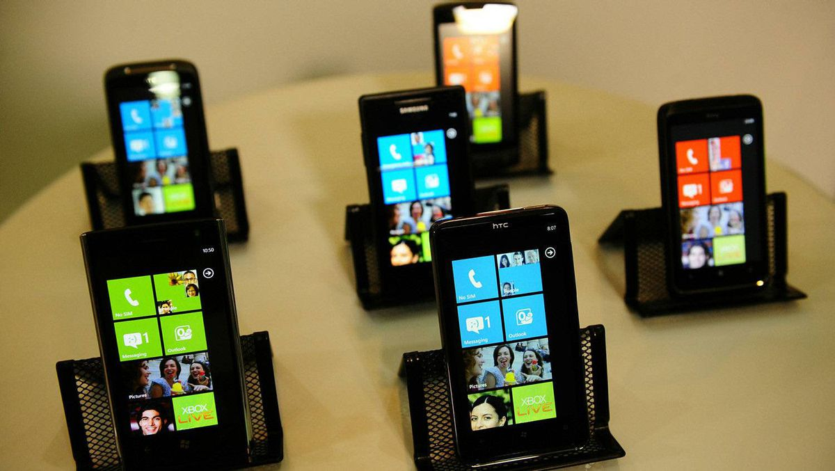 Devices running Windows Phone 7 are on display, a new mobile phone operating system as Microsoft seeks to regain ground lost to the iPhone, Blackberry and devices powered by Google's Android software, during an event in New York, October 11, 2010.