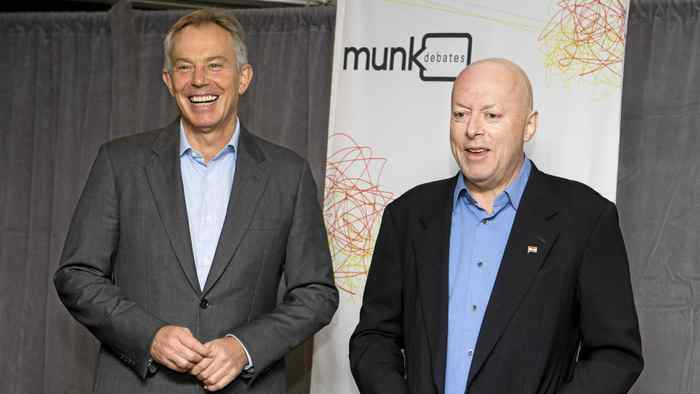 """Former British Prime Minister Tony Blair and author Christopher Hitchens pose ahead of their debate on religion set up by """"Munk Debates"""" in Toronto, Nov. 26, 2010."""