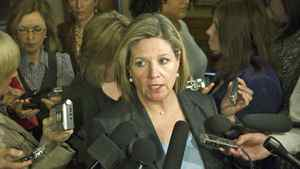 NDP Leader Andrea Horwath is scrummed by the media after the 2012 provincial budget vote at Queen's Park in Toronto on April 24, 2012.