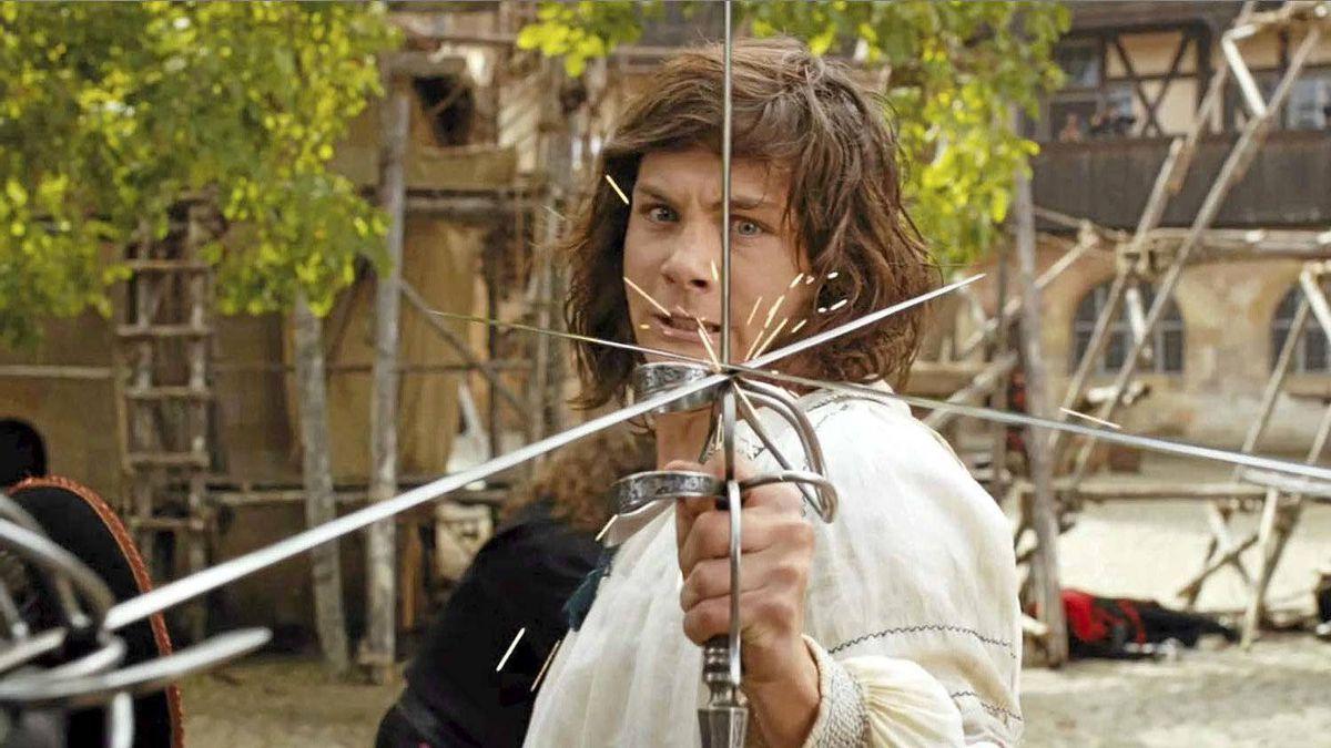 "Logan Lerman as D'Artagnan in a swordy scene from ""The Three Musketeers"""