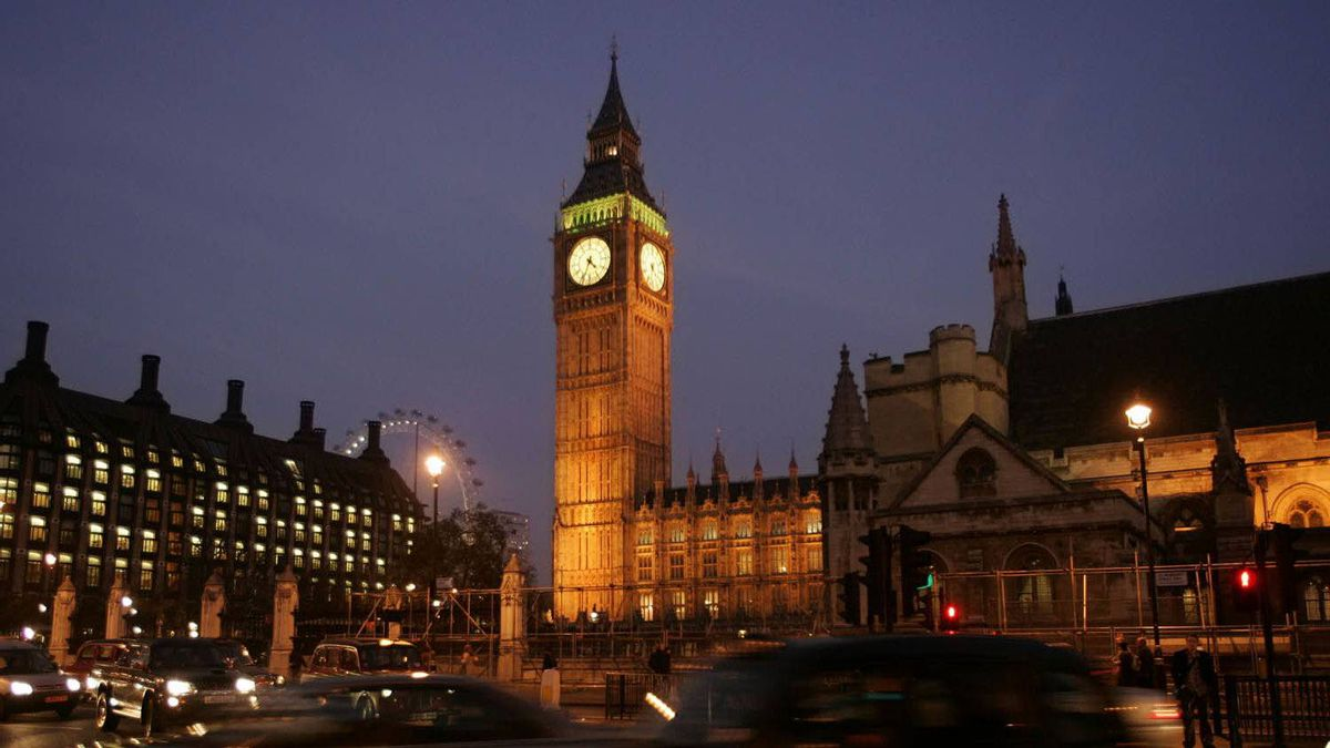 Traffic passes by the House of Parliament in central London, Monday Nov. 21, 2005.