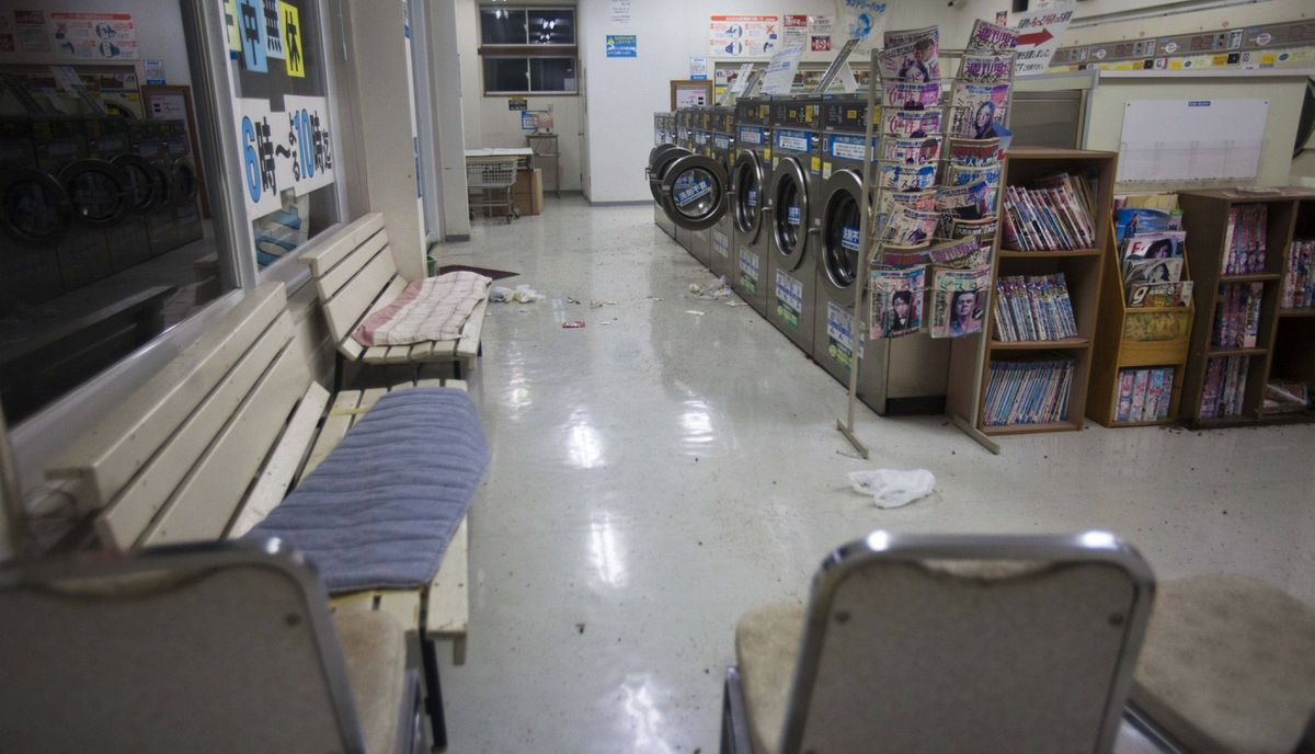 A coin laundry facility sits empty in the town of Namie, inside the 20-kilometer exclusion zone around the Fukushima Daiichi nuclear plant July 17, 2011. A year after the Tsunami, cleanup has begun, but experts say areas inside the nuclear exclusion zone will be difficult to decontaminate.