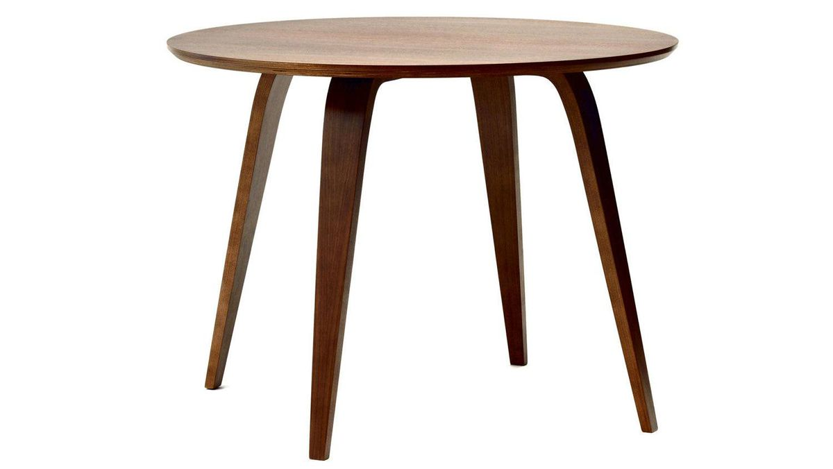 The Cherner Round Table features a solid core of multi-ply beechwood overlaid with a walnut veneer and echoes the curved plywood lines of the iconic Cherner Chair. From $1,799 (U.S.) through www.chernerchair.com.