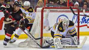 Ottawa Senators left wing Kaspars Daugavins (23) with a shot on goal against Boston Bruins goalie Tim Thomas (30) in the second period at Scotiabank Place.