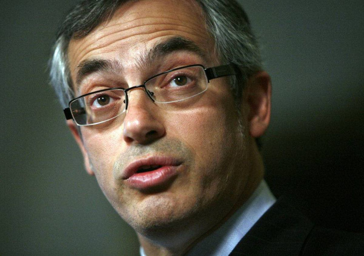 Industry Minister Tony Clement speaks to reporters in the foyer of the House of Commons on April 7, 2009.