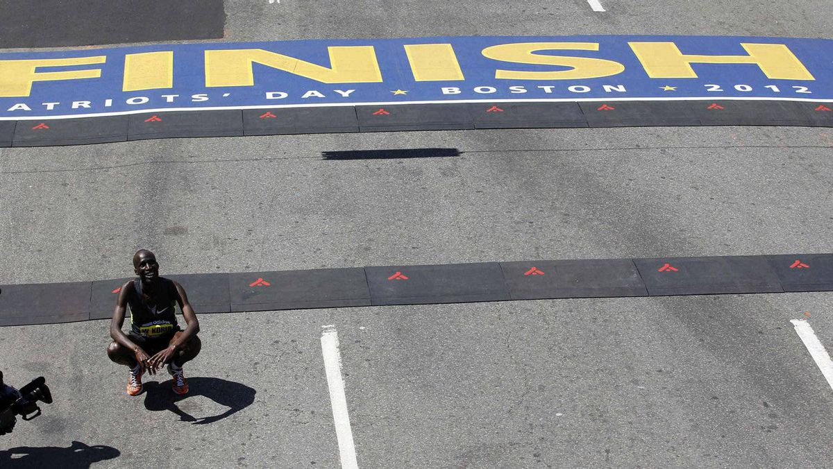 Wesley Korir, of Kenya, smiles after crossing the finish line to win the 116th Boston Marathon in Boston, Massachusetts April 16, 2012.