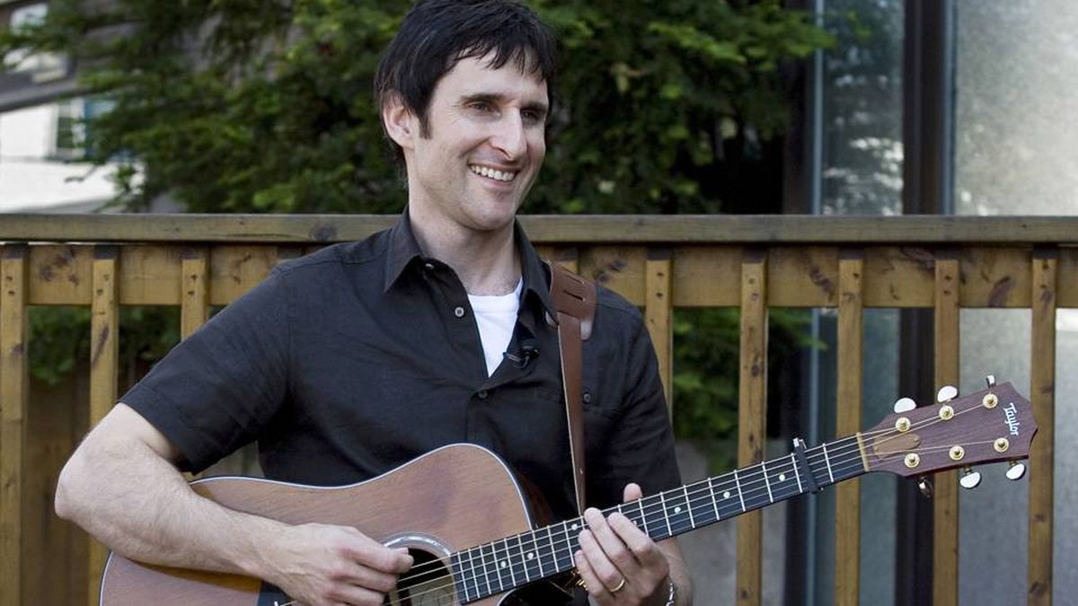 Musician Dave Carroll of the pop-folk band Sons Of Maxwell holds his repaired Taylor guitar in Halifax.