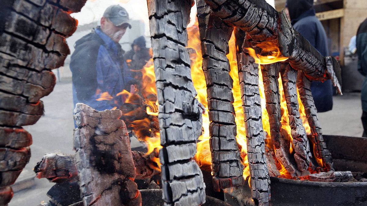 Electro-Motive Canada employees burn pallets to keep warm on the picket line outside the subsidiary of Caterpillar in London on February 8, 2012.
