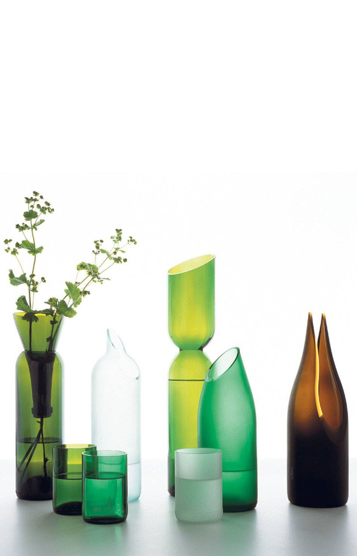PASSING THE BOTTLE Already included in the permanent collection of New York's Museum of Modern Art, Tord Boontje and Emma Woffenden's elegant tranSglass collection of vases, carafes and tumblers for L.A.-based Artecnica may start out as wine bottles, but they emerge from the recycling process as one-of-a-kind objets. And over the past several years, they've been made in Guatemala, where young people are trained in the art of glassmaking. Visit www.artecnica.com for retailers across Canada.