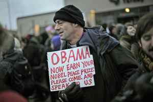 A protestor with a message for U.S. President Barack Obama takes part in a demonstration outside the UN climate change conference in Copenhagen on Wednesday, Dec. 16, 2009.