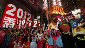 Revellers wave during the New Year celebrations in Hong Kong's Times Square Sunday, Jan. 1, 2012.