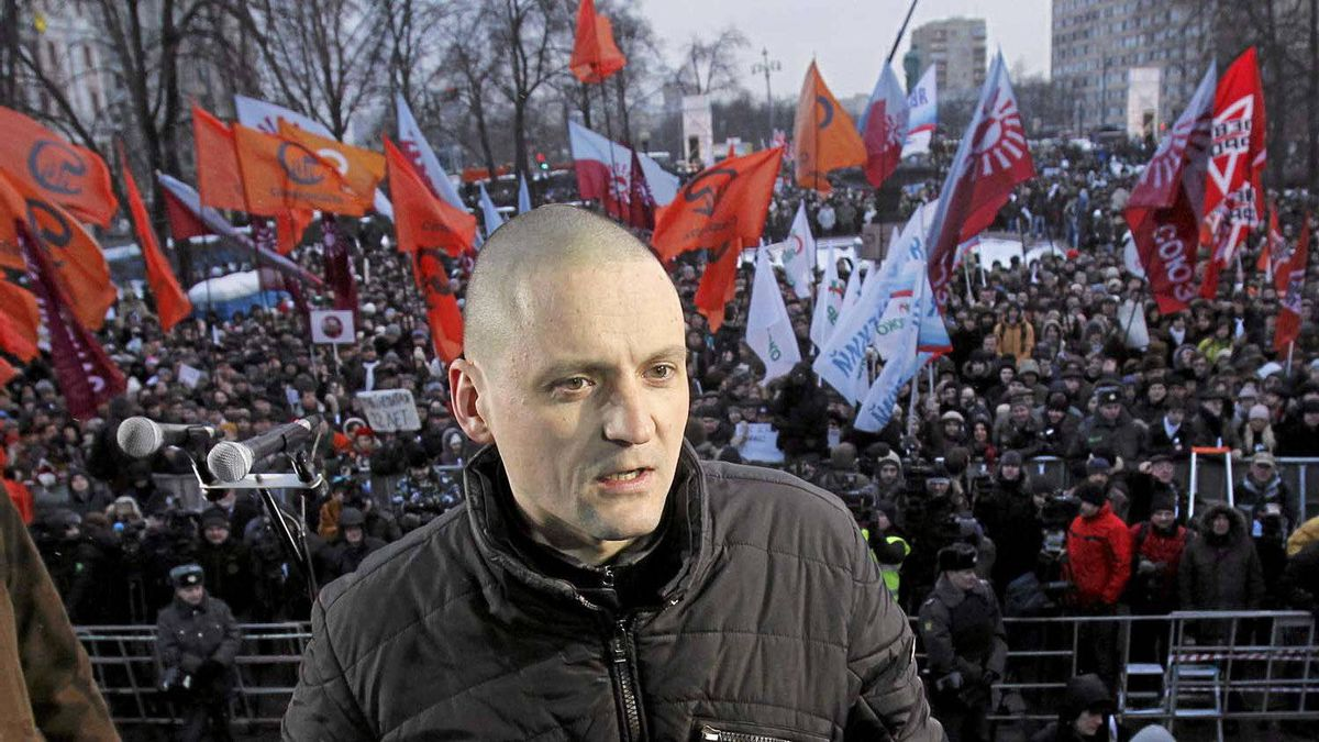 Sergei Udaltsov, leader of opposition party Left Front, speaks to the media before a protest demanding fair elections in central Moscow.