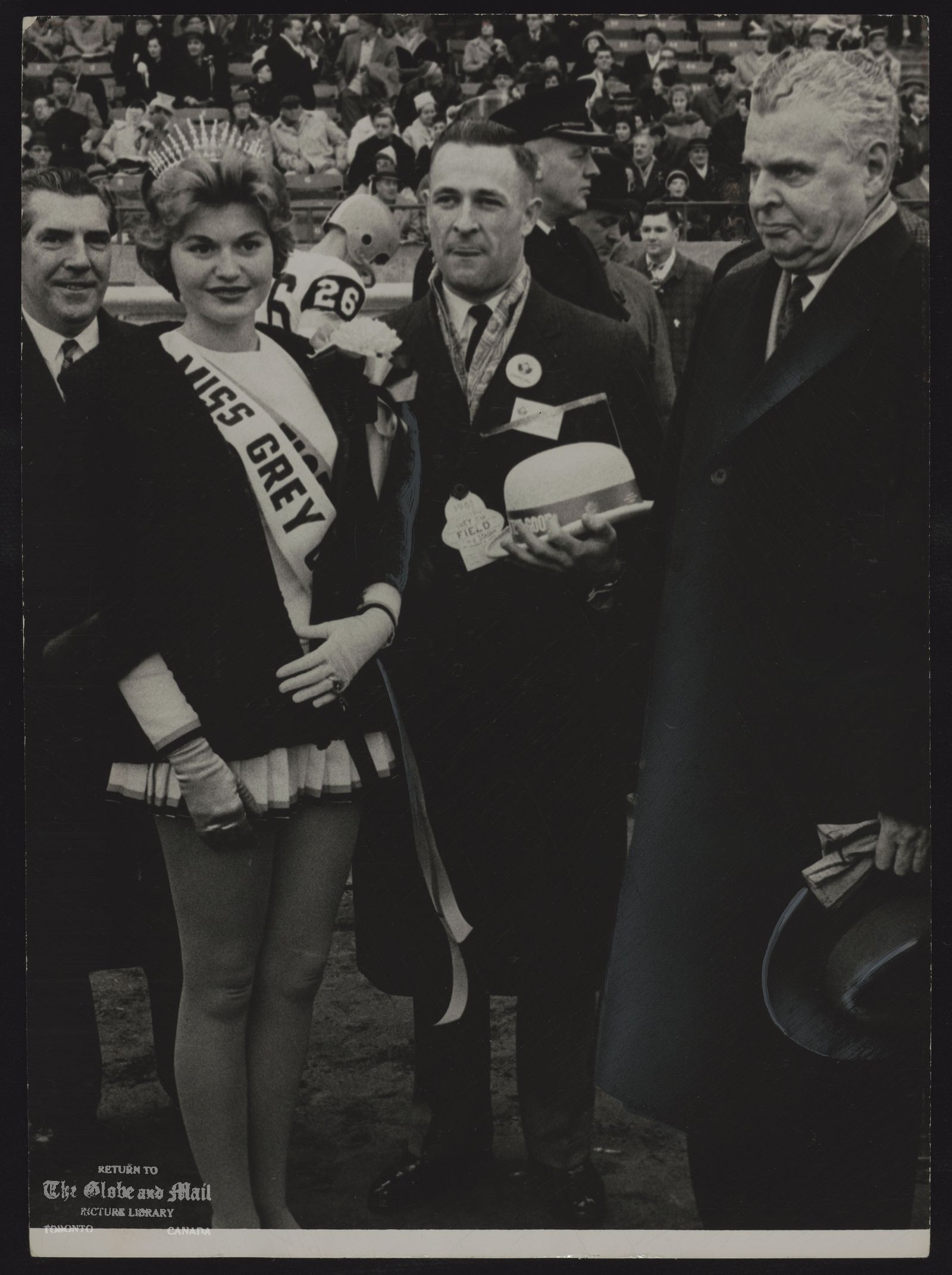 FOOTBALL Grey Cup Miss Grey Cup and Prime Minister John Diefenbaker are hailed by crowd