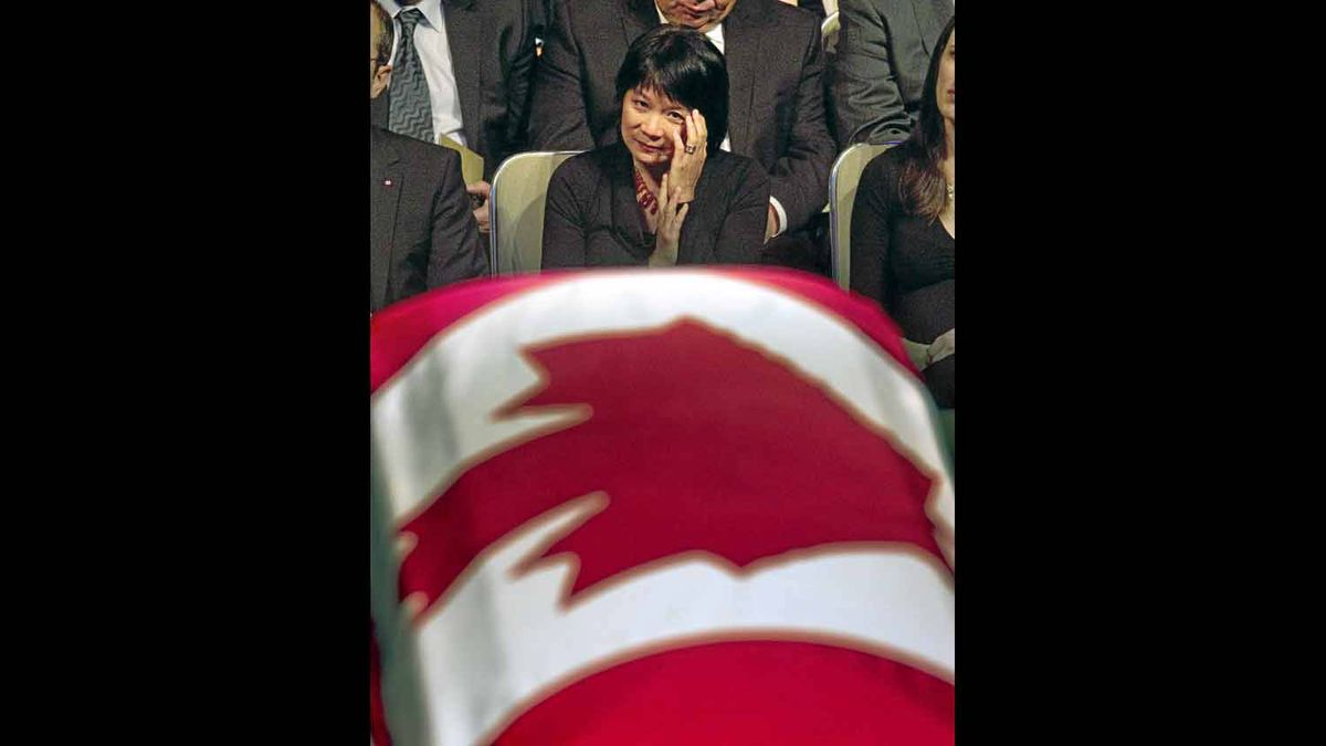 Widow Olivia Chow looks at the coffin of her late husband, NDP leader Jack Layton, during a state funeral at Roy Thomson Hall, in Toronto on Saturday, August 27, 2011.