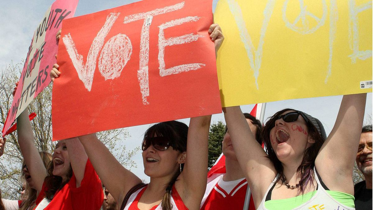 From left, Kelsey Johnson, Shelbie Townson and Brianna Smith, hold signs during a pre-election gathering in London, Ont., Saturday, April 30, 2011.