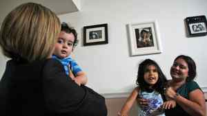 Ontario NDP Leader Andrea Horvath, left, pays a visit to Cristina Carbajal and her two children on Sept. 12, 2011.
