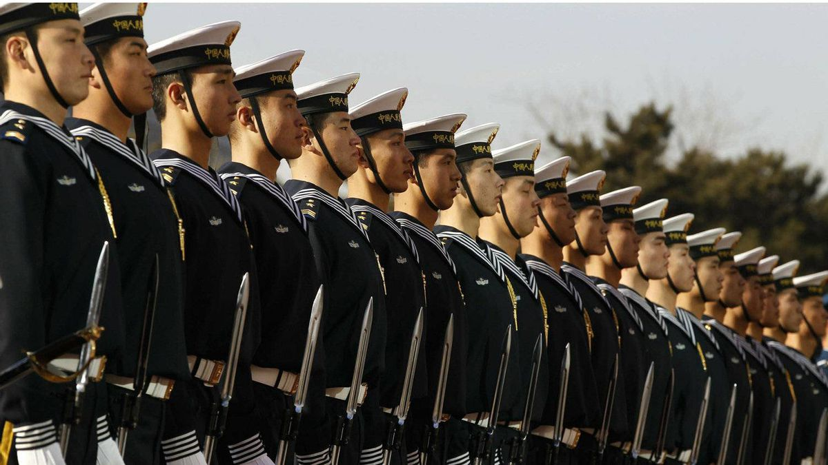 Members of the Chinese Navy honour guard wait for U.S. Secretary of Defense Robert Gates during his visit to Beijing this week.