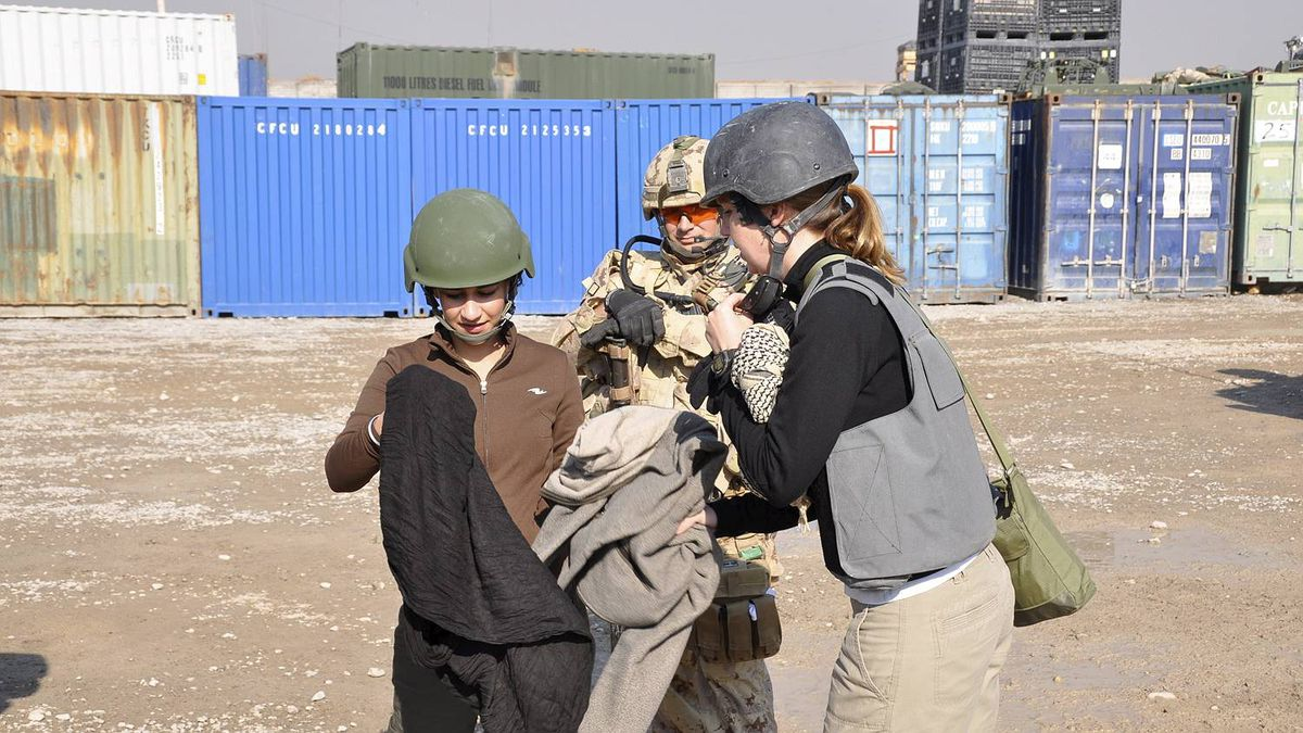 Michelle Lang and Bushra Saeed prepare for a trip off base in Kandahar, Afghanistan, Dec. 30, 2009, with Sgt. Kirk Taylor. Hours later an improvised explosive device destroyed the vehicle they were traveling in on their way back to base, killing both Ms. Lang and Sgt. Taylor, and badly injuring Ms. Saeed.