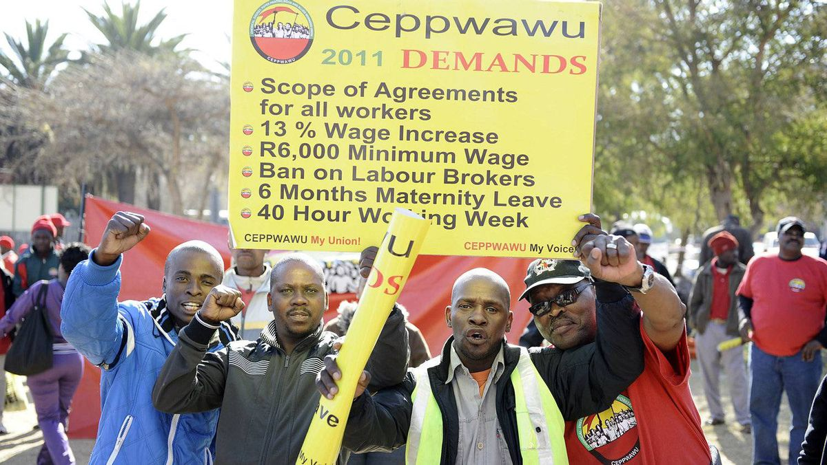 Oil workers are demanding double-digit wage hikes in South Africa. STEPHANE DE SAKUTIN/AFP/Getty Images