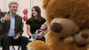 Conservative Leader Stephen Harper speaks to Lianne Hastman, holding her son Henry, during a roundtable in Beaumont, Alta.