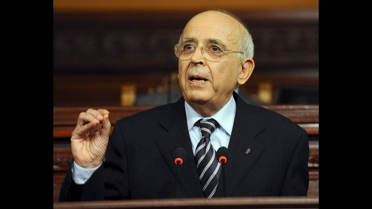 Tunisian Prime Minister Mohamed Ghannouchi delivers a speech at the Chamber of Deputies in Tunis during an extraordinary session aiming at assessing the current situation in Tunisia on Jan. 13, 2011. He announced on state television the next day that he had taken over as interim president after Zine El Abidine Ben Ali had left the country.