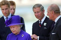 Britain's Queen Elizabeth stands with her husband Prince Philip, son Prince Charles and grandson's princes William and Harry during the unveiling of a memorial fountain dedicated to the late Princess Diana at Hyde Park in London, July 6, 2004.