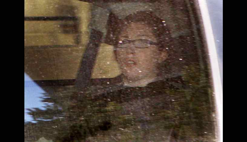 Terri-Lynne McClintic is transported from court for proceedings in the Michael Rafferty murder trial in London, Ontario, Wednesday, March, 21, 2012.