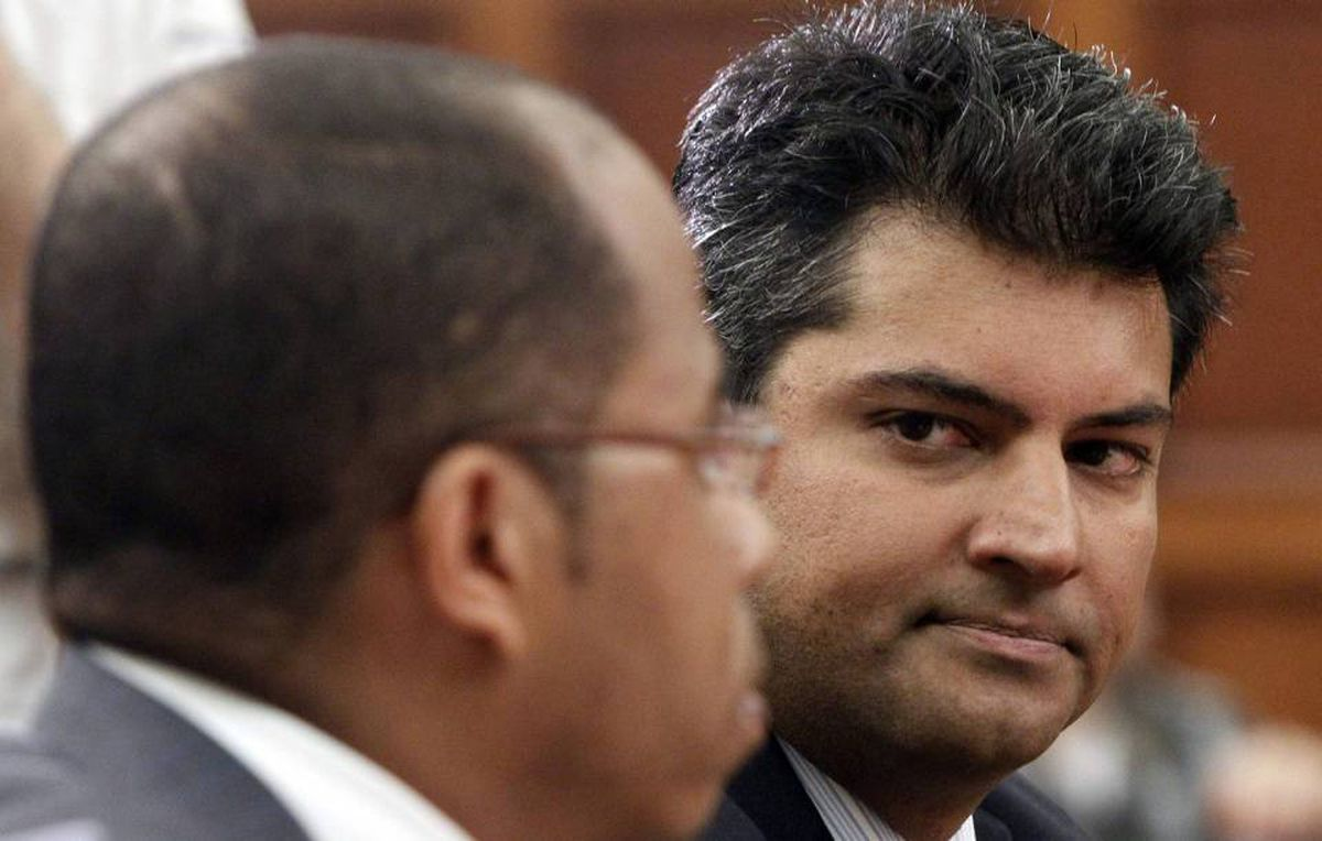 Former Conservative MP Rahim Jaffer waits to testify with business partner Patrick Glemaud before the Commons government operations committee in Ottawa on April 21, 2010.