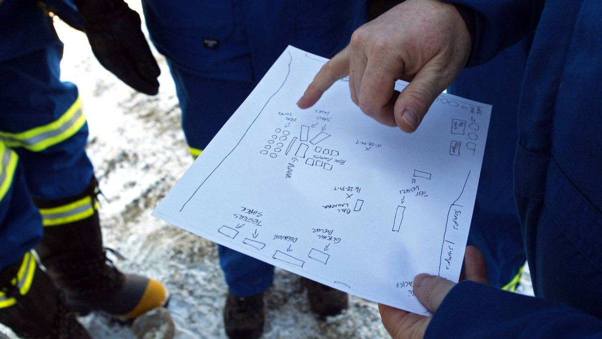 NAL Resources managers discuss a hydraulic fracturing operation near Bowden, Alta., Tuesday, Feb. 14, 2012