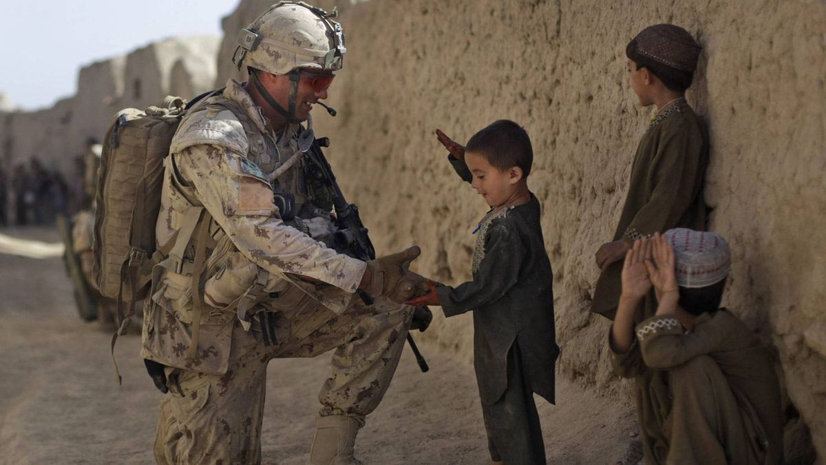 Afghan children greet a Canadian soldier with the 1st Battalion, The Royal Canadian Regiment, patrolling Salavat, Panjwayi district, southwest of Kandahar, Afghanistan.