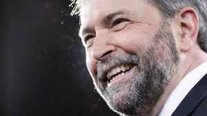 New NDP leader Thomas Mulcair smile on stage during the NDP leadership convention in Toronto on Saturday,