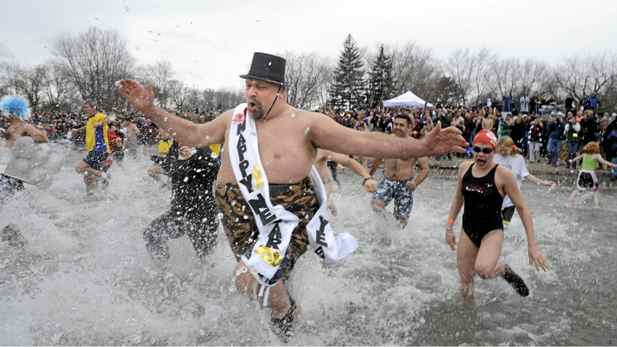 Over 500 people brave the cold waters of Lake Ontario as they take part in the 25th anniversary Courage Brother's Polar Bear Dip for World Vision